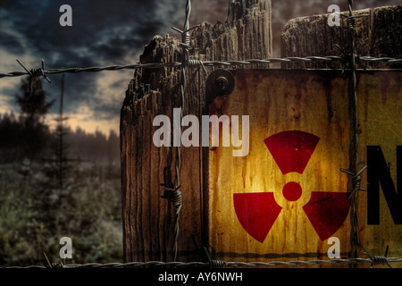 Rusty sign with radiation (trefoil) symbol - Stock Image
