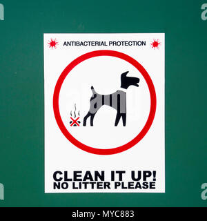 A green bin for disposal of dog mess in a public park marked Antibacterial Protection  Clean it up  No Litter Please - Stock Image