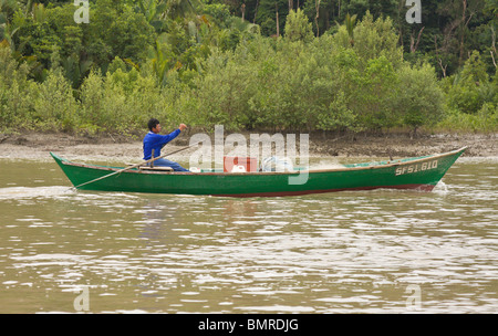 Fisherman in traditional boat, Borneo - Stock Image