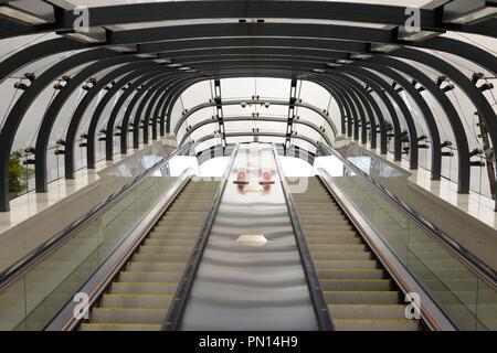 Twin escalators looking skyward at Kelvingrove underground subway station in Glasgow, Scotland, UK - Stock Image