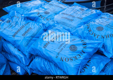 Blue plastic bags of  Taybrite smokeless fuel - Stock Image