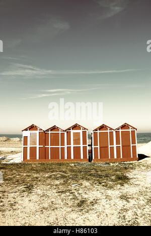 old wooden cabins on the beach - Stock Image
