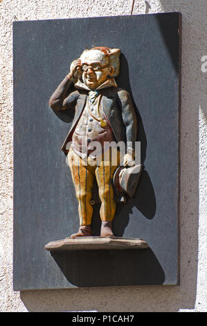Carved figure of a man on the wall of a Pub on Rue Ntore Dame Beaume France - Stock Image