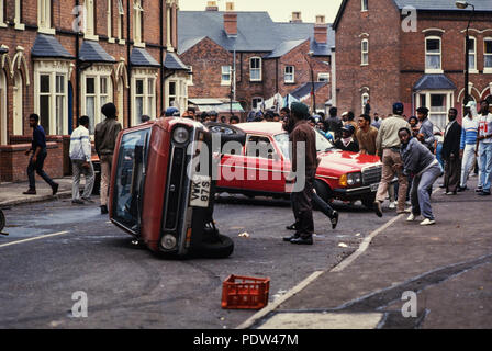 Handsworth Riots, Birmingham, Engalnd September 1985 The second Handsworth riots took place in the Handsworth district of Birmingham, West Midlands, from 9 to 11 September 1985. The riots were reportedly sparked by the arrest of a man near the Acapulco Cafe, Lozells and a police raid on the Villa Cross public house in the same area. Hundreds of people attacked police and property, looting and smashing, even setting off fire bombs.  Two brothers (Kassamali Moledina, 38, and his 44-year-old brother Amirali)[1] were burnt to death in the post office that they ran.[2] Two other people were unaccou - Stock Image