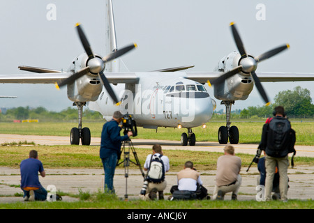 Croatian Air Force An-32B transport aircraft taxiing after landing before mass of press people, Pleso AB 'open - Stock Image