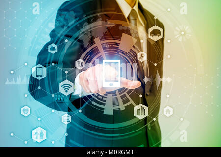 business person pointing symbolic icon, internet of things, conceptual abstract - Stock Image