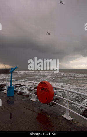 Promenade at Aberystwyth with approaching rain cloud.. - Stock Image