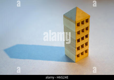 Wooden blocks representing a tower block like building. - Stock Image