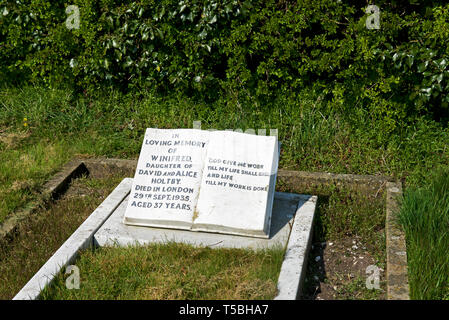The grave of Winifred Holtby, author of South Riding, in the graveyard of All Saints Church, Rudston, East Yorkshire, England UK - Stock Image