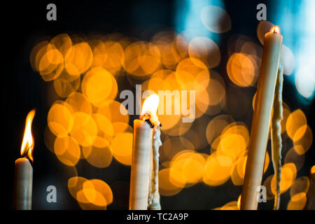 Votive candles, El Rocio sanctuary Andalusia, Spain. - Stock Image