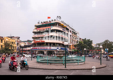 The Highlands Coffee building at Dong Kinh Nghia Thuc Square roundabout junction in Hanoi city, Vietnam - Stock Image