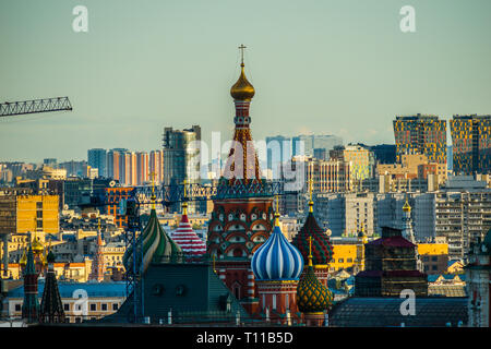 MOSCOW, AUGUST 8, 2018: Beautiful view of Moscow city and St. Basil's cathedral at summer sunset. New tall residential buildings in the background. Ho - Stock Image