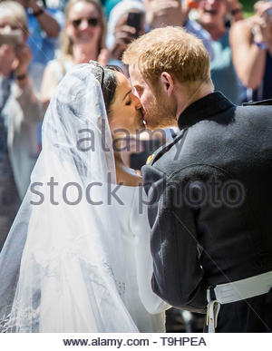 File photo dated 19/05/18 of The Duke and Duchess of Sussex kissing on the steps of St George's Chapel at Windsor Castle, following their wedding. The Duke and Duchess of Sussex celebrate their first wedding anniversary on Sunday - and are a family of three with the arrival of baby Archie. - Stock Image