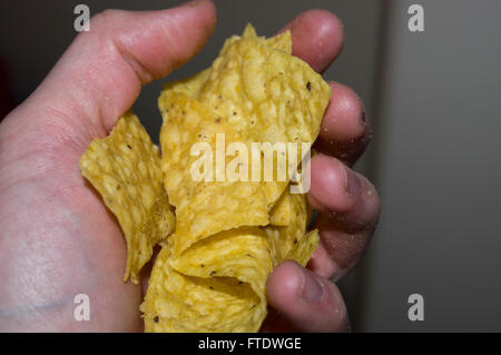 corn chips,Mexican , hand, chips - Stock Image