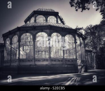"""An atmospheric image of the """"Palacio de Cristal"""" or Crystal Palace, Buen Retiro Park, in the heart of Madrid, the capital city of Spain. A must visit tourist attraction! Photo © COLIN HOSKINS. - Stock Image"""