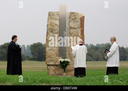 Priests Rainer Jenke (L), Gerhard Ortmann (C) and Winfried Zimmermann (R) hold a oecumenical service in Lathen, - Stock Image