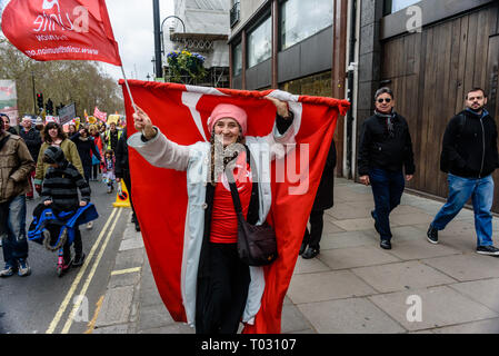 London, UK. 16th March 2019. Woman with Turkish flag. Thousands march through London on UN Anti-Racism day to say 'No to Racism, No to Fascism' and that 'Refugees Are Welcome Here', to show solidarity with the victims of racist attacks including yesterdays Christchurch mosque attack and to oppose Islamophobic hate crimes and racist policies in the UK and elsewhere. The marchers met in Park Lane where there were a number of speeches before marching to a rally in Whitehall. Marches took place in other cities around the world including Glasgow and Cardiff. Peter Marshall/Alamy Live News - Stock Image