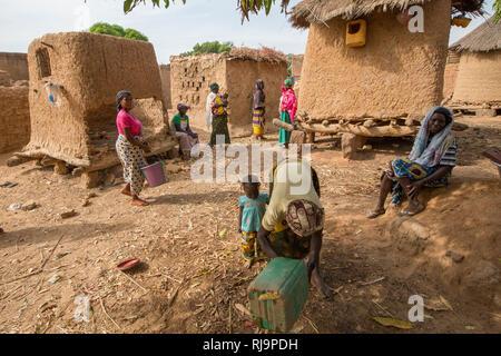 Kisambo Village, Yako, Burkina Faso, 28th November 2016; women gathering to walk to the village's market garden. - Stock Image