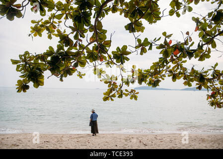 Woman standing on the beach, Thailand - Stock Image