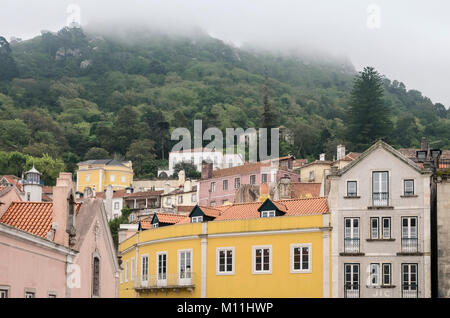 Morning mist on hilltops over Sintra, a resort town in the foothills of Sintra Mountains, Sintra, near Lisbon, Portugal - Stock Image
