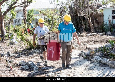 All Hands Volunteers clean up debris during relief efforts in the aftermath of Hurricane Irma November 10, 2017 - Stock Image