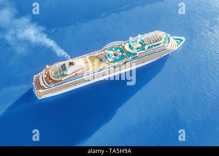 Luxury cruise ship sailing across the sea. Aerial view at sunny day - Stock Image
