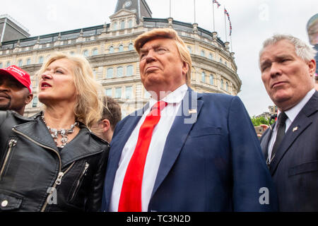 A Donald Trump impersonator walks the streets of London with Protestors at Trafalgar Square demonstrating against the state visit of Donald Trump - Stock Image