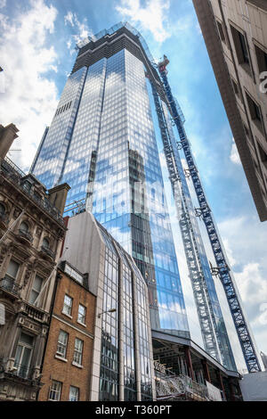 View of the partly glazed new skyscraper office block, 22 Bishopsgate, under construction in the City of London finacial district, EC2 reflecting Towe - Stock Image