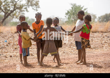 Samba village, Yako Province, Burkina Faso; children playing together. - Stock Image