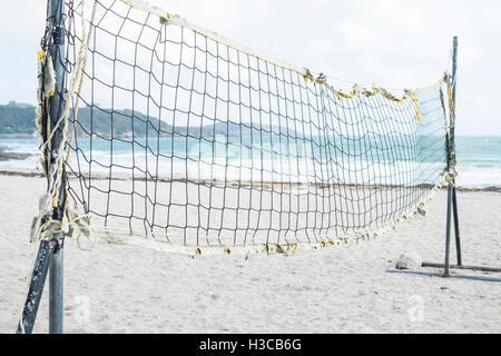Beach volleyball net at Gyllyngvase (Gylly) beach, Falmouth Cornwall. - Stock Image