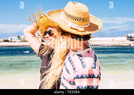 Cheerful happy couple enjoy the summer holiday vacation together in tropical place with blue sea and sky in background - People having fun and love in - Stock Image