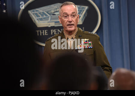 The chairman of the Joint Chiefs of Staff, Marine Corps Gen. Joseph F. Dunford, speaks at a joint press conference with U.S. Secretary of Defense James N. Mattis, at the Pentagon, Arlington, Va., Aug. 28, 2018. DoD photo by Lisa Ferdinando - Stock Image