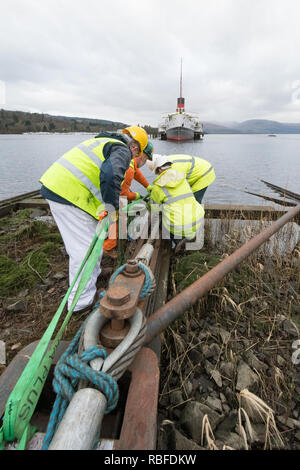 Balloch, Loch Lomond, Scotland, UK. 10th Jan, 2018. final preparations underway to haul The Maid of the Loch from Loch Lomond. Attaching ropes at the end of the slipway Credit: Kay Roxby/Alamy Live News - Stock Image