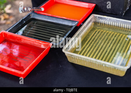 Processing dishes of the wet photographic developing process. Developing and fixing solutions - Stock Image