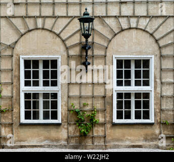 Symmetric two windows with a lamp by the middle in Munich, Germany, Bavaria. - Stock Image