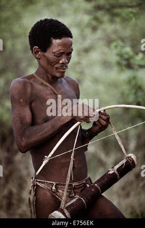 African Kalahari tribesman with bow & arrow - Stock Image
