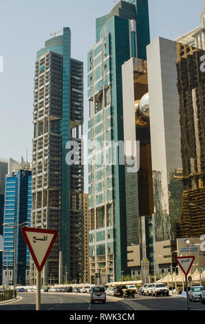 Modern skyscrapers with traffic signs and cars; Doha, Qatar - Stock Image