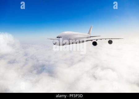 Huge two-storey passengers commercial airplane flying above clouds in sunny day. Concept of fast travel, holidays and business. - Stock Image