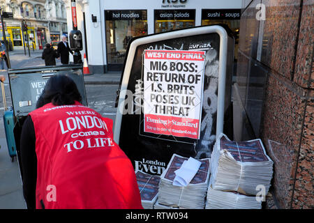 Evening Standard newspaper poster in Brixton street  'MI6 Boss: Return of I.S. Brits Poses UK Threat'  South London UK  KATHY DEWITT - Stock Image