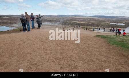 Geysir, South Iceland: Tourists spread out on pathway betwween two of ICelands largesy geysers - Stock Image