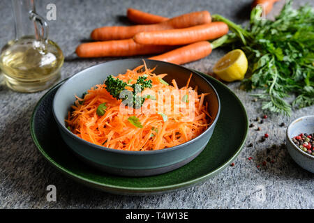 Healthy grated carrot salad with lemon juice and olive oil - Stock Image