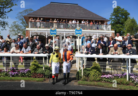 Jockeys make their way out for the Sky Bet Race To The Ebor Jorvik Handicap during day one of the Dante Festival at York Racecourse. - Stock Image