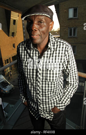 London, UK - 15 August 2012: Afro-jazz musician Oliver Mtukudzi poses for photos ahead of a concert at the O2 in London. The legendary musician from Zimbabwe, whose lyrics often carried social messages about HIV/Aids and coded political commentary.Photo: David Mbiyu/ Alamy Live News - Stock Image