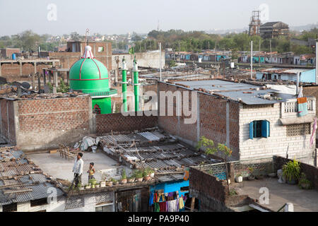 View on Arif Nagar area, with abandoned Union Carbide industrial complex at the back, Bhopal, India - Stock Image
