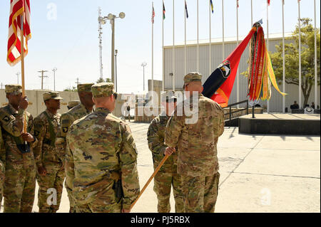 Col. Craig J. Alia officially relinquishes command of the 101st Combat Aviation Brigade while passing the brigade colors to Maj. Gen. Andrew P. Poppas, 101st Airborne Division (Air Assault) and Resolute Support deputy chief of staff for operations, during a change of command ceremony held at Bagram Airfield, Afghanistan, Aug. 25. Poppas, who presided over the ceremony, then charged Col. Matthew R. Weinshel with the responsibility of commanding Task Force Destiny and the only aviation brigade of the world's only air assault division. Alia will move on and assume responsibilities as the Chief of - Stock Image