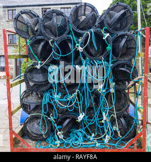 plastic shrimp pots stacked on a trailer - Stock Image