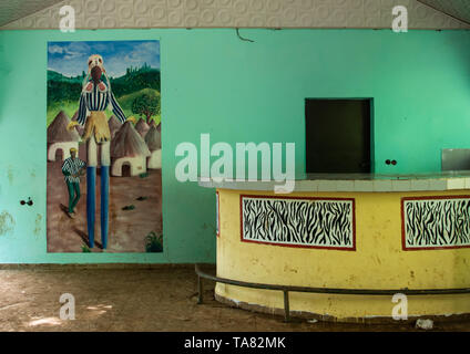 Empty bar decorated with a mural depitinf a Dan tribe masked dancer, Tonkpi Region, Man, Ivory Coast - Stock Image