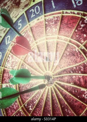 Dart board and darts - Stock Image