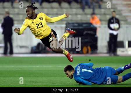 Brussels, Belgium. 21st Mar, 2019. BRUSSELS, BELGIUM - MARCH 21, 2019: Belgium's Michy Batshuayi (L) and Russia's goalkeeper Guilherme Marinato in action in their UEFA Euro 2020 qualifying football match at King Baudouin Stadium. Anton Novoderezhkin/TASS Credit: ITAR-TASS News Agency/Alamy Live News - Stock Image