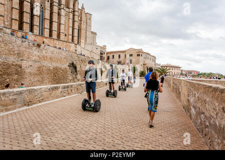 Tourists on the segwayz at the Dalt Murada in the old town of Palma, Palma, Mallorca, Spain, Europe - Stock Image